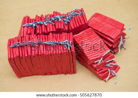 Red firecrackers on brown background, dangerous