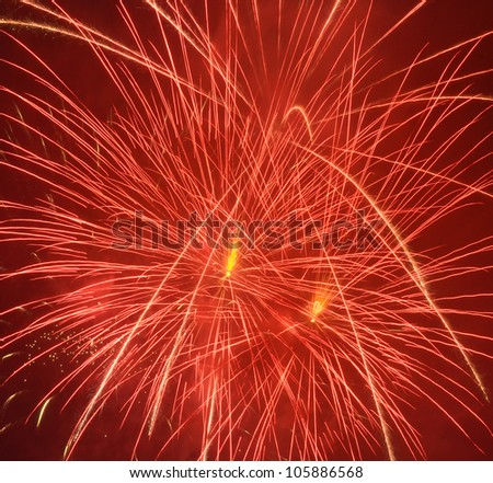 red firework in night sky - stock photo