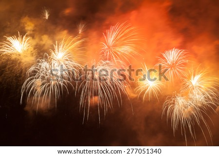 Red fireworks in the night sky - stock photo