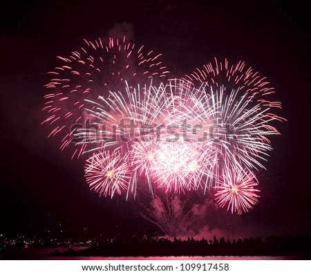 red fireworks with people looking in the bottom. - stock photo