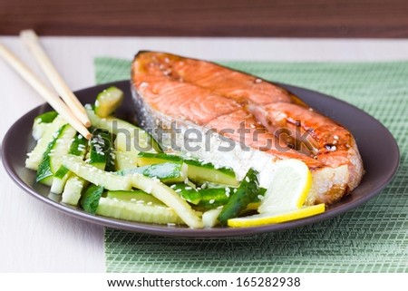 Red fish grilled salmon with cucumber salad and soy sauce, Japanese food - stock photo