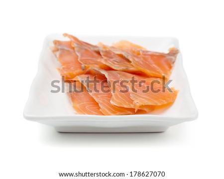 Red fish on white plate. Shallow dof. - stock photo