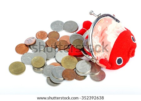 Red fish  purse and coins on white background