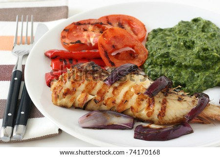 red-fish with spinach and grilled vegetables