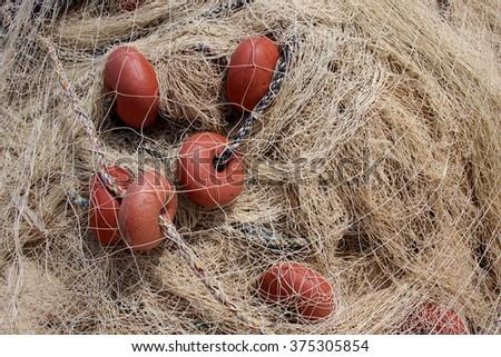 Red fishing net, fishermans equipment  - stock photo