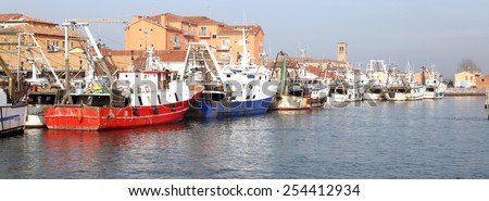 red fishing vessel other ships moored in the harbor of the Mediterranean Sea - stock photo
