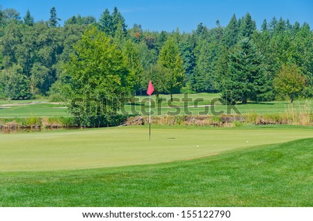 Red flag at a beautiful golf course. Canada, Vancouver.