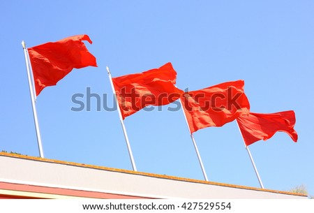red flags on the roof - stock photo