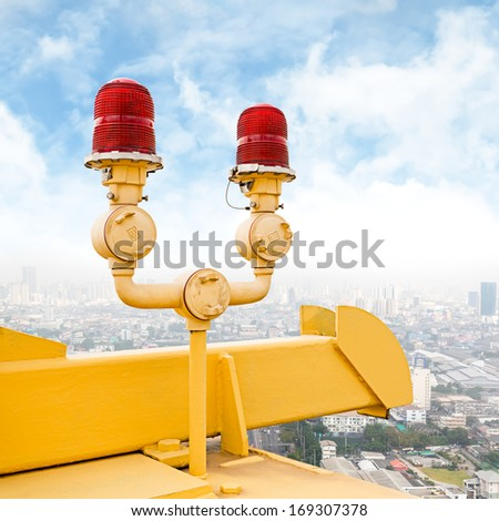 Red flashing beacon on public bridge for alarm helicopter - stock photo