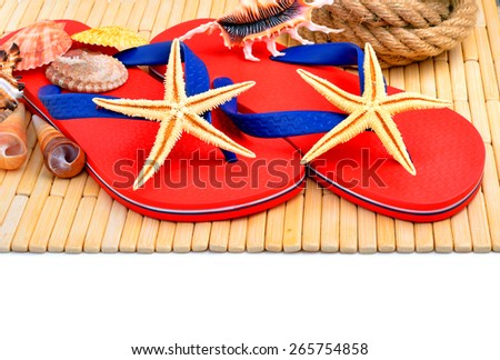 Red flip-flops, slippers with starfish on the wooden background isolated on white - stock photo