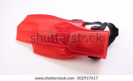 Red flippers for scuba diving or snorkelling. Isolated on white background. Slightly de-focused and close-up shot. Copy space.