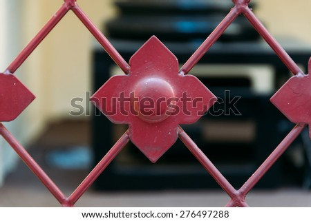 red flower shape of fence - stock photo