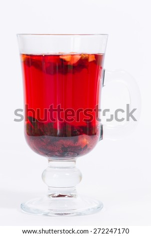 Red flowers fruit tea isolated in the transparent glass - stock photo