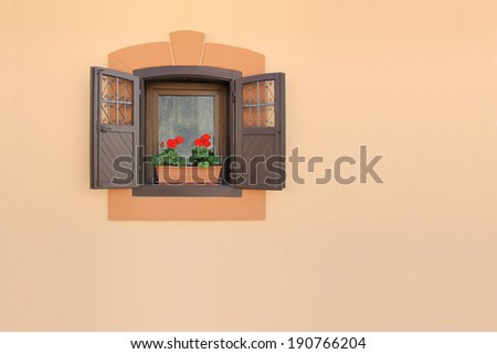 Red flowers on a old brown wooden window  - stock photo