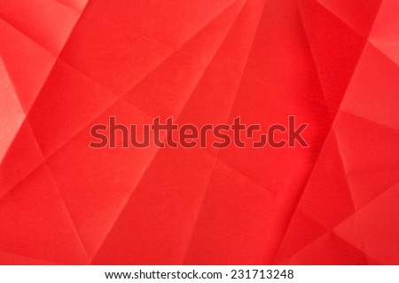 Red folded paper surface abstract - stock photo