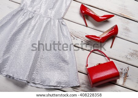 Red footwear and leather purse. Shelf with red heel shoes. Woman's beautiful red leather bag. Low prices in fashion store. - stock photo