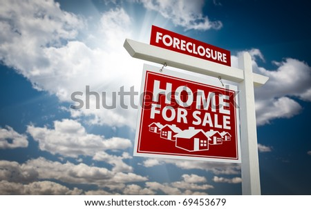 Red Foreclosure Home For Sale Real Estate Sign Over Beautiful Clouds and Blue Sky. - stock photo