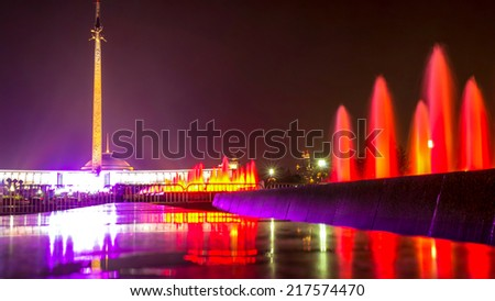 Red fountains near Second World War Victory obelisk in Victory park in Moscow, Russia. Memorial complex dedicated to victory of Russians over Nazi Germany in 1941-1945 was completed in mid-1990s. - stock photo