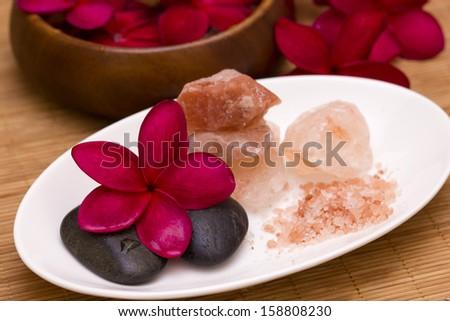 Red frangipani with salt soap crystal - stock photo
