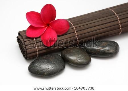 Red Frangipani With Zen Stone - stock photo