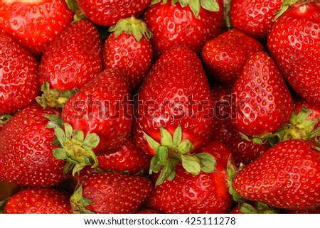 Red fresh mellow strawberry berries close up background