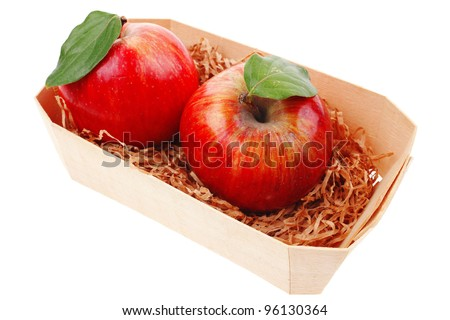 red fresh ripe twins apple packed with wooden box isolated over white background