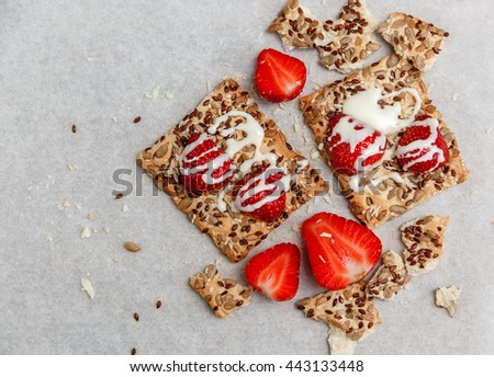 Red Fresh Strawberries are on the Cracker with Grains.Evaporated Milk  on the White Paper.Breakfast Organic Healthy Tasty Food.Cooking Vitamins Ingredients.Summer Fruits.Top View - stock photo