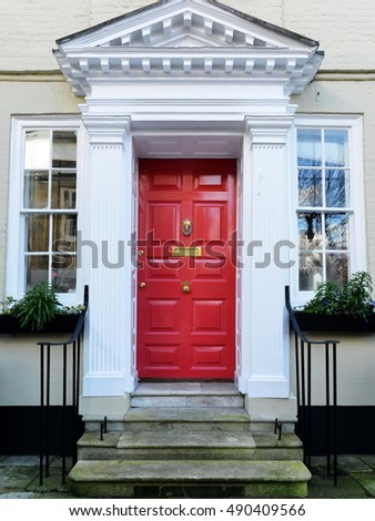 red front doors. Red Front Door of an Attractive Old London Town House Stock Photo 490409566