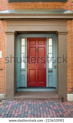 Red Front Door with Blue Door Frame and Windows on Tan Building with TIle