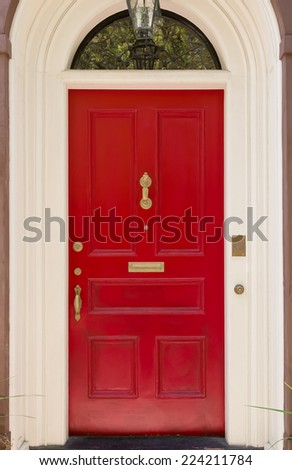 Red Front Door with White Archway Door Frame - stock photo