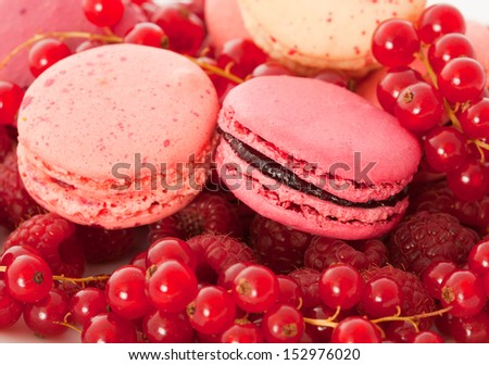 Red fruit flavored macarons with the berries - stock photo