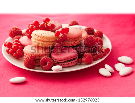 Red fruit flavored macarons with the berries