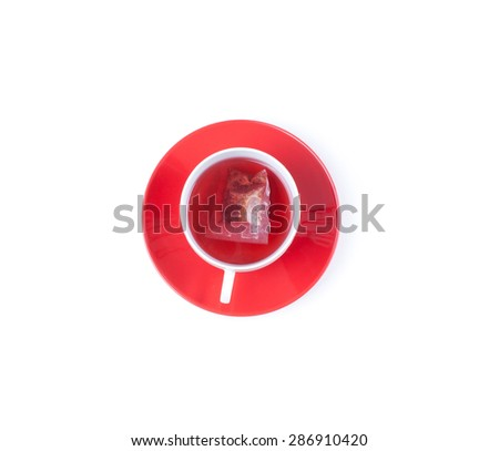 Red fruit tea in transparent  cup with tea bag with blank label, top view isolated on white background with clipping path. Healthy tea drinking. - stock photo