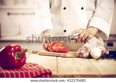 red fruits and cook hands  - stock photo