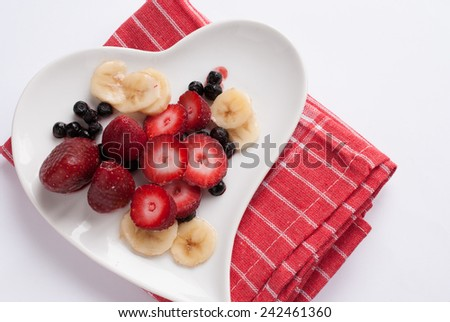 Red fruits on a white plate
