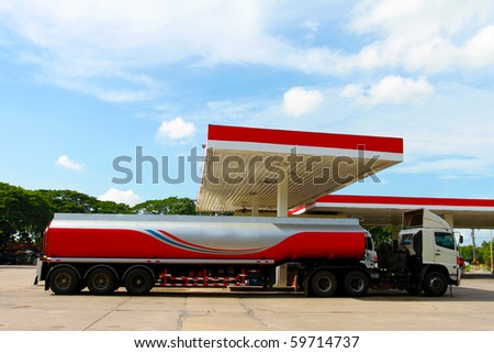 Red fuel truck in gas station - stock photo