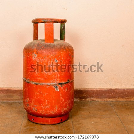 Red gas cylinder on pink cylinder - stock photo
