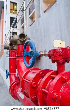 red gas pipe with blue valve