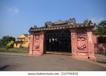 Red gate of Japanese Bridge in Hoi An at night, Vietnam  - stock photo