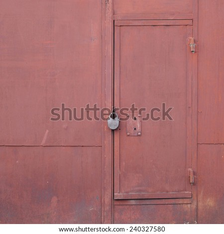 red gate with a padlock