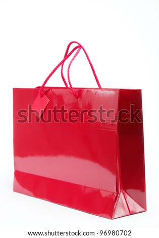 Red gift bag on a white background.