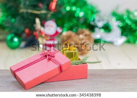 red gift box and decorations christmas on wood background
