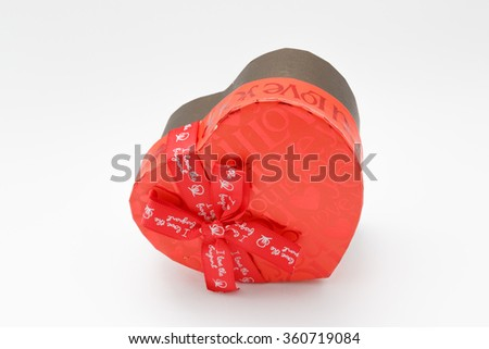 red gift box in heart shape.Happiness, valentines day love and celebrating concept