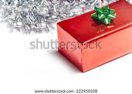 Red gift box on white background with christmas decoration - stock photo