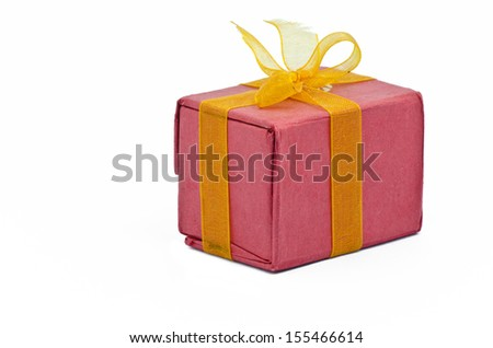 Red Gift box, tied with a gold bow, Isolated on white background - stock photo