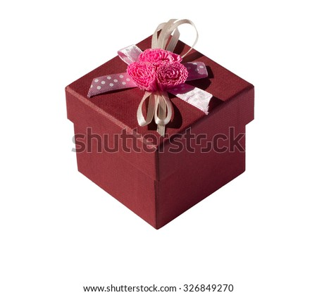 Red gift box with flower and ribbon. - stock photo