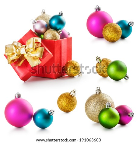 Red gift box with gold ribbon and christmas balls collection on white background  - stock photo