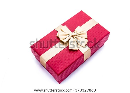 Red gift box with gold ribbon on white background.