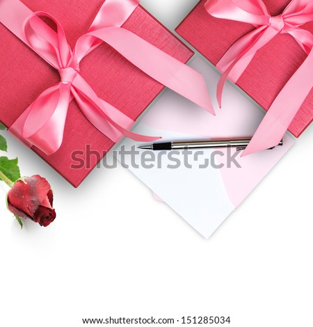 Red gift box with greeting card