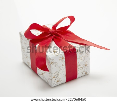 red Gift box with ribbon and bow isolated on the white background